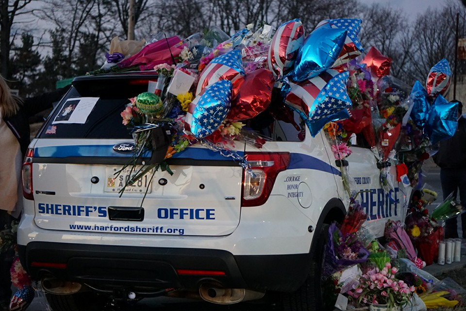 Sheriff's vehicle with memorial balloons